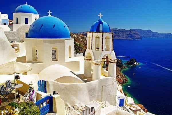 | greece santorini blue roof churches and mediterranean